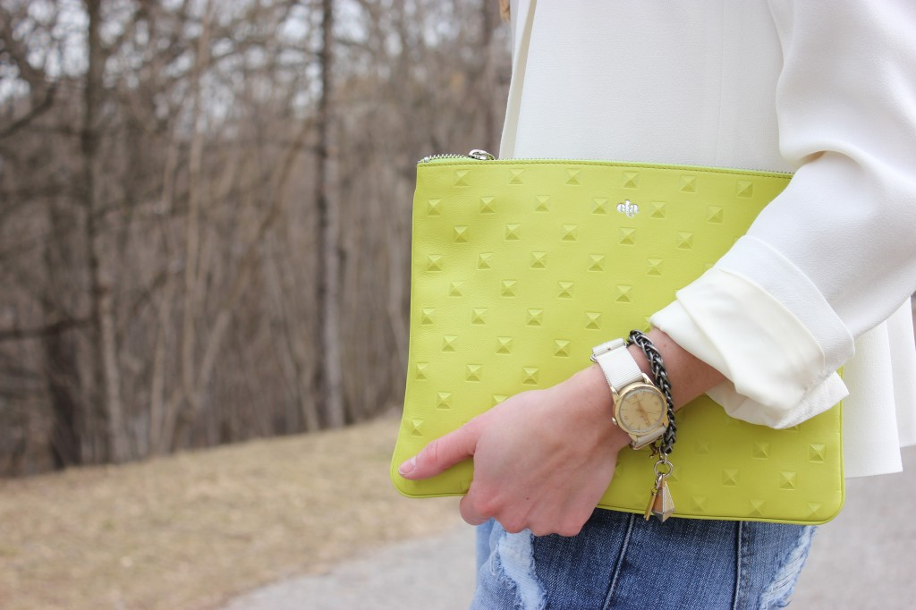 Girl holding green purse.