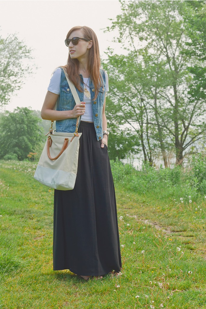 Style Bee in black maxi skirt, White crop tee, denim vest, with canvas tote