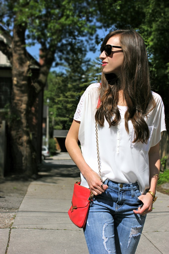 Style Bee in a white top, ripped jeans and Botkier bag.