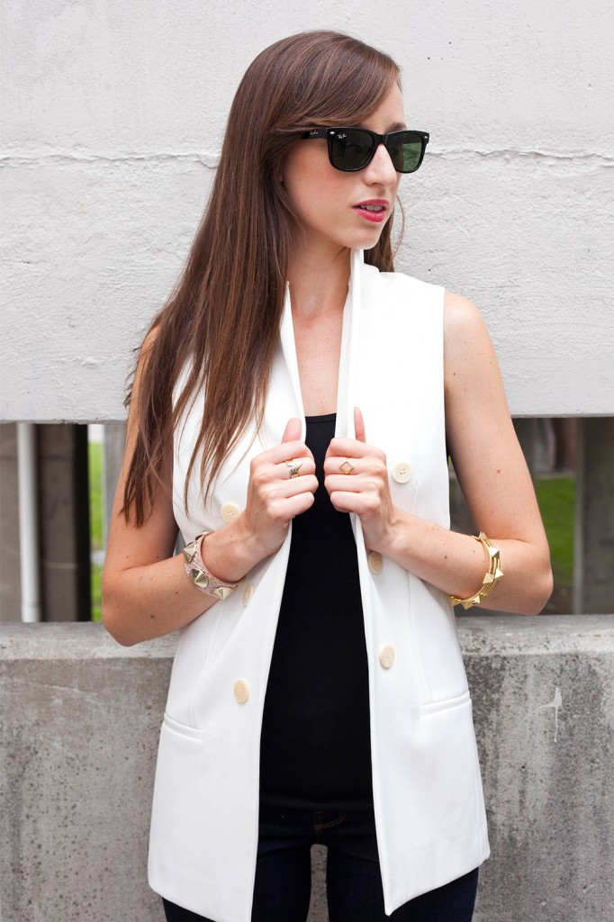 Style Bee in a white vest and black top with RayBan sunglasses